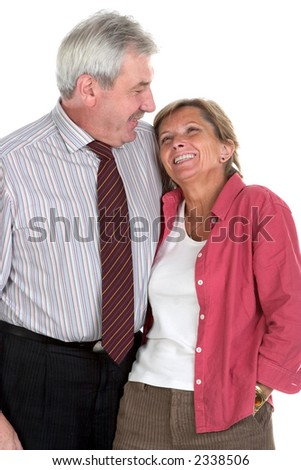 Middleaged couple hugs and smiles, isolated on white - stock photo