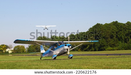 MIDDLESEX, VA - SEPTEMBER 27, 2014:A Bellanca Citabria 115 waiting to cross the runway at Hummel field airport in the wings wheels and keels annual show at the Hummel airfield airstrip in Middlesex VA