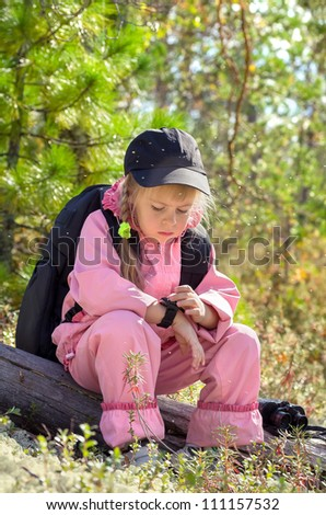 Midges in the Siberian taiga. The child looks at the compass. - stock photo