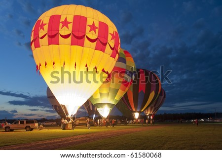 "MIDLAND, MICHIGAN-SEPTEMBER 17:  Hot air balloons in the 20th annual Balloon Festival are illuminated for a ""Night Glow""  in Midland, MI  on September 17, 2010. This year 65 balloons participated."