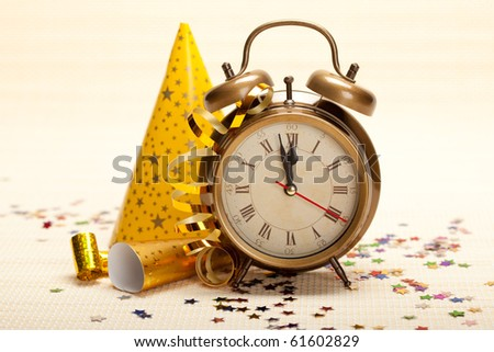 Midnight - clock face and decorations - stock photo