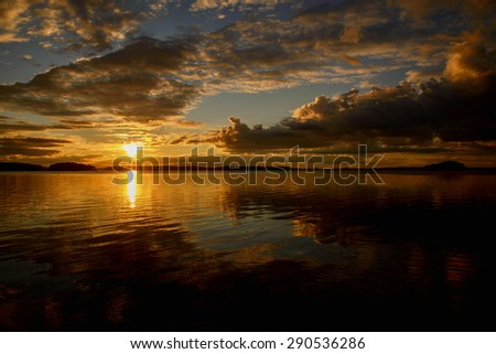 Midnight light over calm lake in Sweden - stock photo