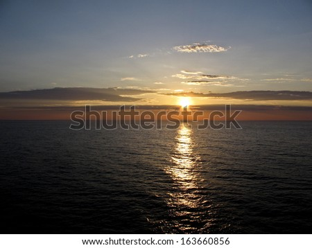 midnight sun in the arctic   circle - stock photo