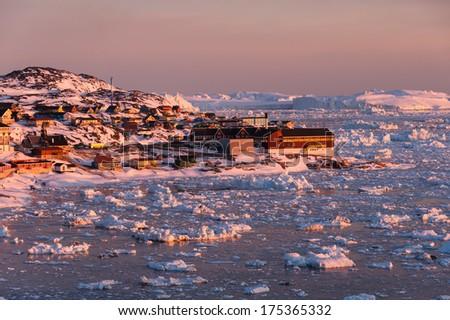 Midnight sun light in Ilulissat, North Greenland - stock photo