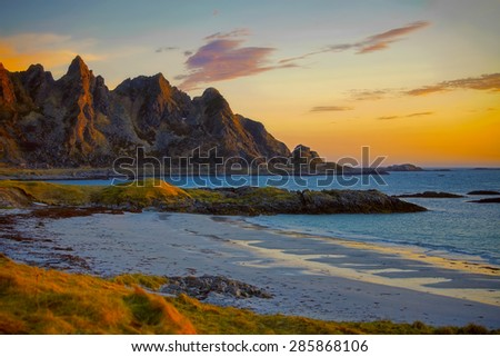 Midnight sun shining over the majestic landscape of Vesteralen, Norway - stock photo