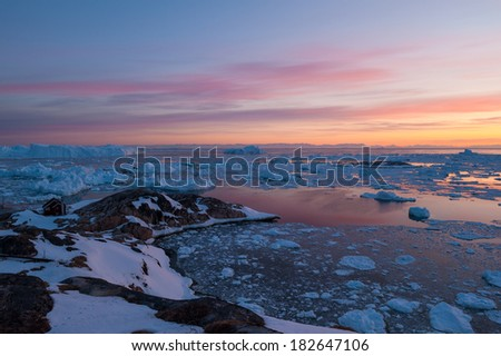 Midnight sunlight in Ilulissat, Greenland - stock photo