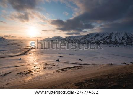 Midnight sunset. Svalbard, Norway - stock photo