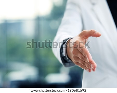 Midsection of a businesswoman with an open hand ready to seal a deal  - stock photo