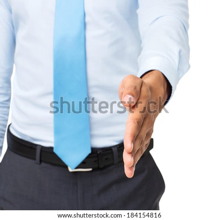 Midsection of businessman offering handshake against white background. Horizontal shot.
