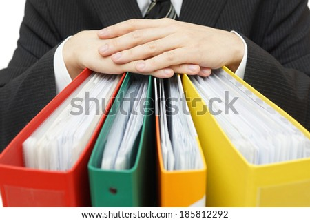 Midsection of businessman with binders at office - stock photo