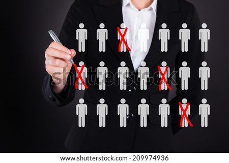 Midsection of businesswoman striking out employees representing recruitment - stock photo