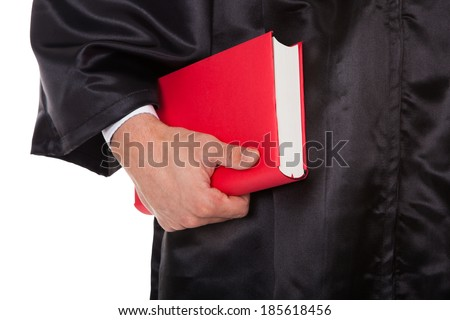 Midsection of male judge holding statute book against white background - stock photo