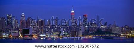 Midtown Manhattan from NJ, Night, New York - stock photo