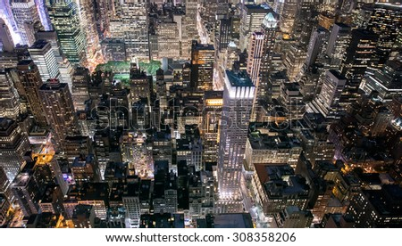 Midtown Manhattan (New York) lit up from above. - stock photo