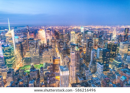 Midtown Manhattan night aerial skyline.