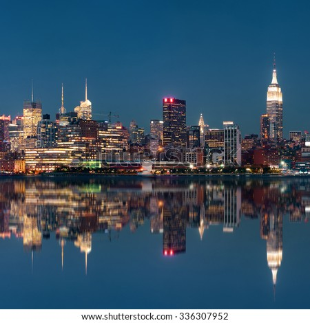 Midtown Manhattan skyline at dusk panorama over Hudson River with reflections - stock photo