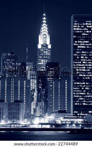 Midtown Manhattan skyline at Night, New York City - stock photo