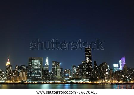 Midtown Manhattan Skyline At Night, New York City - stock photo