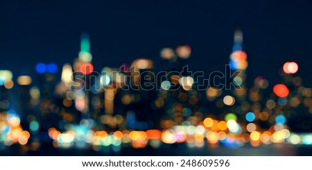 Midtown Manhattan skyline bokeh at dusk panorama over Hudson River - stock photo