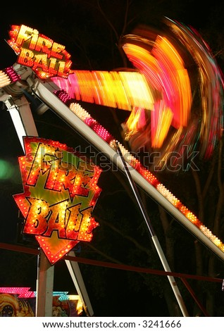 midway ride at the fair - stock photo