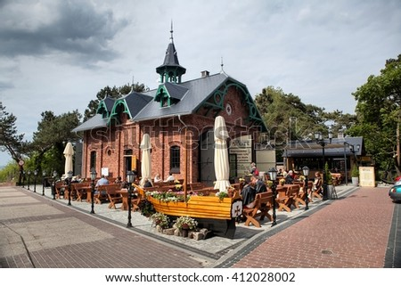 MIEDZYZDROJE, POLAND-JUN 23, 2015: Miedzyzdroje is a town and a seaside resort in northwestern Poland on the island of Wolin on the Baltic coast. - stock photo