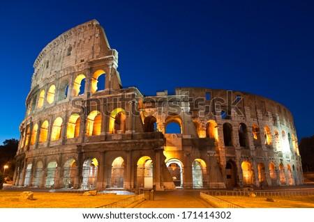 Mighty Coliseum (AD 80), illuminated at night, Rome, Italy. - stock photo