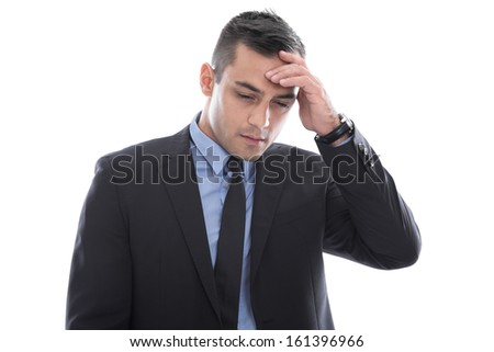 Migraine: young businessman with headache in business suit isolated on white background - stock photo