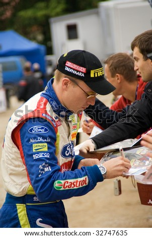 MIKOLAJKI, POLAND - JUNE 26: Jari Matti LATVALA of Finland gives autographs during Rally Poland June 26-28, 2009 in Mikolajki, Poland