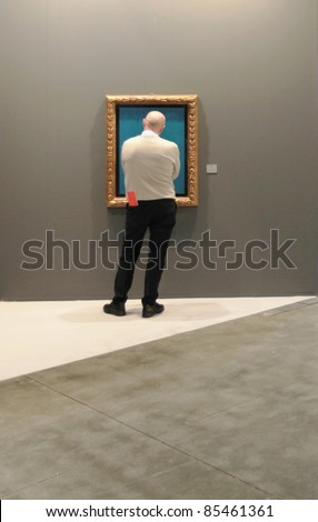 MILAN - APRIL 08: An unidentified man looks at paintings and sculpture galleries during MiArt, international exhibition of modern and contemporary art on April 08, 2011 in Milan, Italy - stock photo