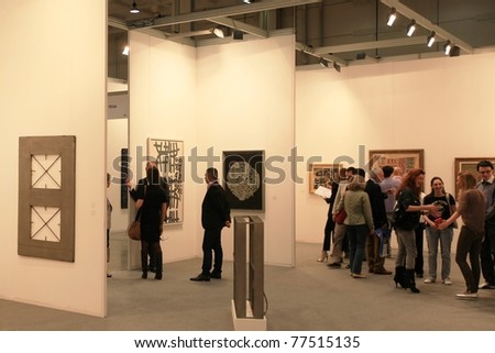 MILAN - APRIL 08: Looking at paintings and sculpture galleries during MiArt, international exhibition of modern and contemporary art on April 08, 2011 in Milan, Italy - stock photo