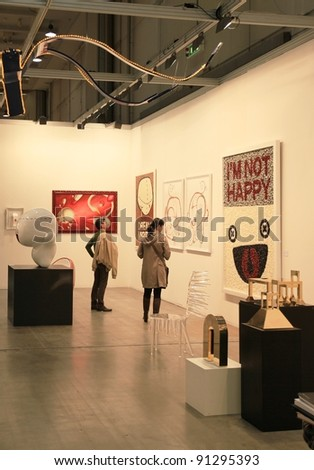 MILAN - APRIL 08: Looking at paintings galleries during MiArt, international exhibition of modern and contemporary art on April 08, 2011 in Milan, Italy. - stock photo