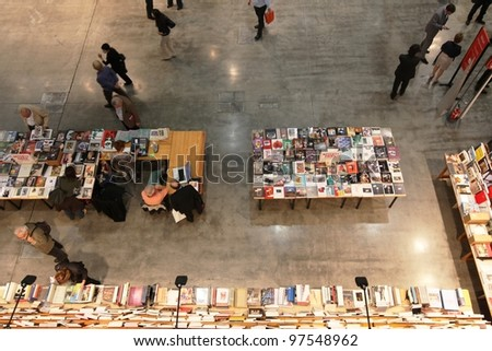 MILAN - APRIL 08: Panoramic view of people visiting arts book shop during MiArt, international exhibition of modern and contemporary art on April 08, 2011 in Milan, Italy. - stock photo