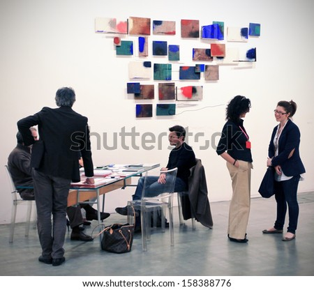 MILAN - APRIL 08: Peopl talking while visiting paintings galleries during MiArt, international exhibition of modern and contemporary art on April 08, 2011 in Milan, Italy  - stock photo