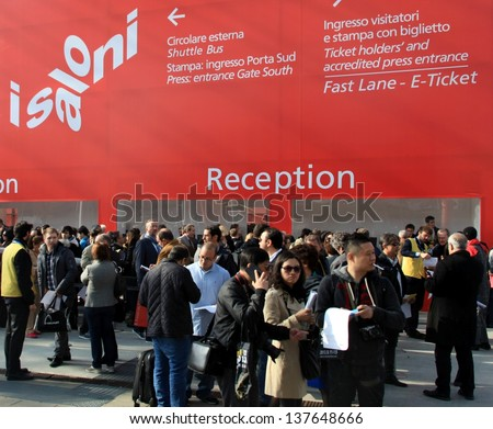 MILAN - APRIL 10: People at reception before entering Salone del Mobile, international home furnishing design and accessories exhibition on April 10, 2013 in Milan, Italy.