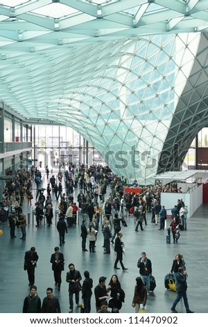 MILAN - APRIL 17: People at the entrance of Salone del Mobile, annual international furnishing accessories exhibition on April 17, 2012 in Milan, Italy. - stock photo