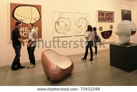 MILAN - APRIL 08: People look at painting and sculpture art galleries during MiArt ArtNow, international exhibition of modern and contemporary art on April 08, 2011 in Milan, Italy. - stock photo