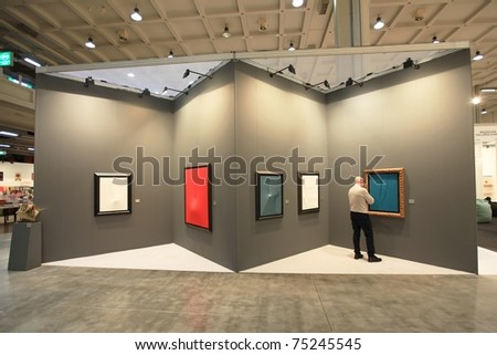 MILAN - APRIL 08: People look at painting galleries during MiArt ArtNow, international exhibition of modern and contemporary art April 08, 2011 in Milan, Italy. - stock photo