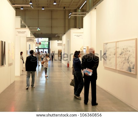 MILAN - APRIL 08: People look at paintings and sculpture galleries during MiArt, international exhibition of modern and contemporary art on April 08, 2011 in Milan, Italy - stock photo