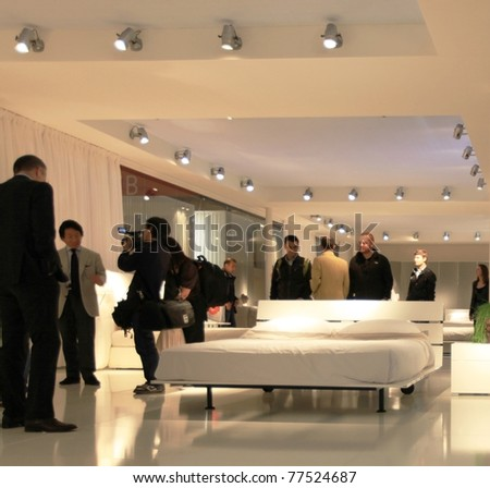 MILAN - APRIL 13: People visit interiors design stands looking for home architecture solutions at Salone del Mobile, international furnishing accessories exhibition on April 13, 2011 in Milan, Italy.