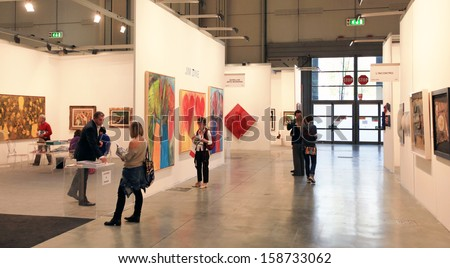 MILAN - APRIL 08: Women look at paintings galleries during MiArt, international exhibition of modern and contemporary art on April 08, 2011 in Milan, Italy  - stock photo