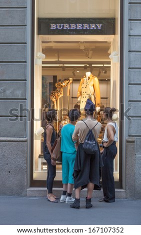 MILAN - AUGUST 24: People visit Burberry store on August 24, 2013 in Milan. Burberry exists since 1856 and has 473 stores. Business Weekly says Burberry is the 98th most valuable brand worldwide - stock photo