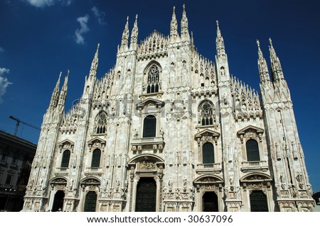 Milan Cathedral (Italian: Duomo di Milano; Milanese: Domm de Milan) is the cathedral church of Milan in Lombardy, northern Italy. It is the seat of the Archbishop of Milan - stock photo