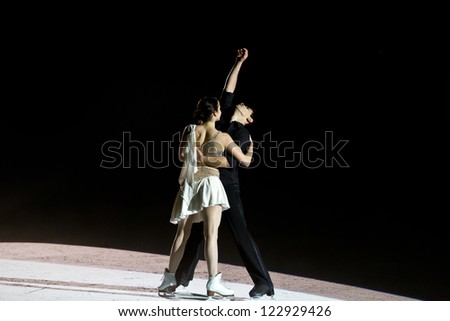 MILAN -DEC 22:  Anna Cappellini and Luca Lanotte perform in a skating show on Dec 22, 2012 in Milan, italy. - stock photo