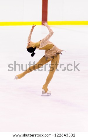 MILAN-DECEMBER 22: Micol Cristini   perform in Italian Championships of Figure Skating 2012 on December 22 , 2012 in Milan, Italy - stock photo
