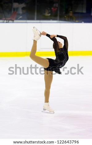 MILAN-DECEMBER 22:  Silvia Lovison perform in Italian Championships of Figure Skating 2012 on December 22 , 2012 in Milan, Italy - stock photo