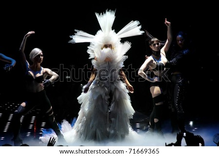MILAN - DECEMBER 04: Singer Lady Gaga during the first concert in Milan on December 4, 2010 in Assago, Milan, Italy. - stock photo