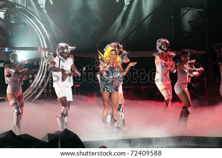 MILAN - DECEMBER 04: Singer Lady Gaga during the first concert in Milan on December 4, 2010 in Assago, Milan, Italy. - stock photo