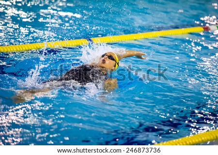 MILAN - DECEMBER  23: V. Neri performing backstroke  in  Swimming Meeting Brema Cup on December  23, 2014 in Milan, Italy.