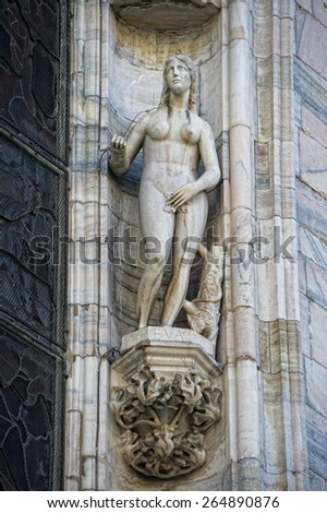 Milan Dome gothic Cathedral EVE statue detail - stock photo