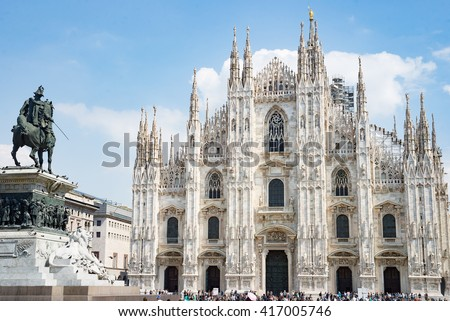 Milan Duomo cathedral main square with statue knight - stock photo
